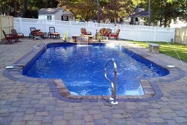 a picture of a rectangle inground swimming pool with 4 radius corners stairs - Rectangle Pool With Water Feature