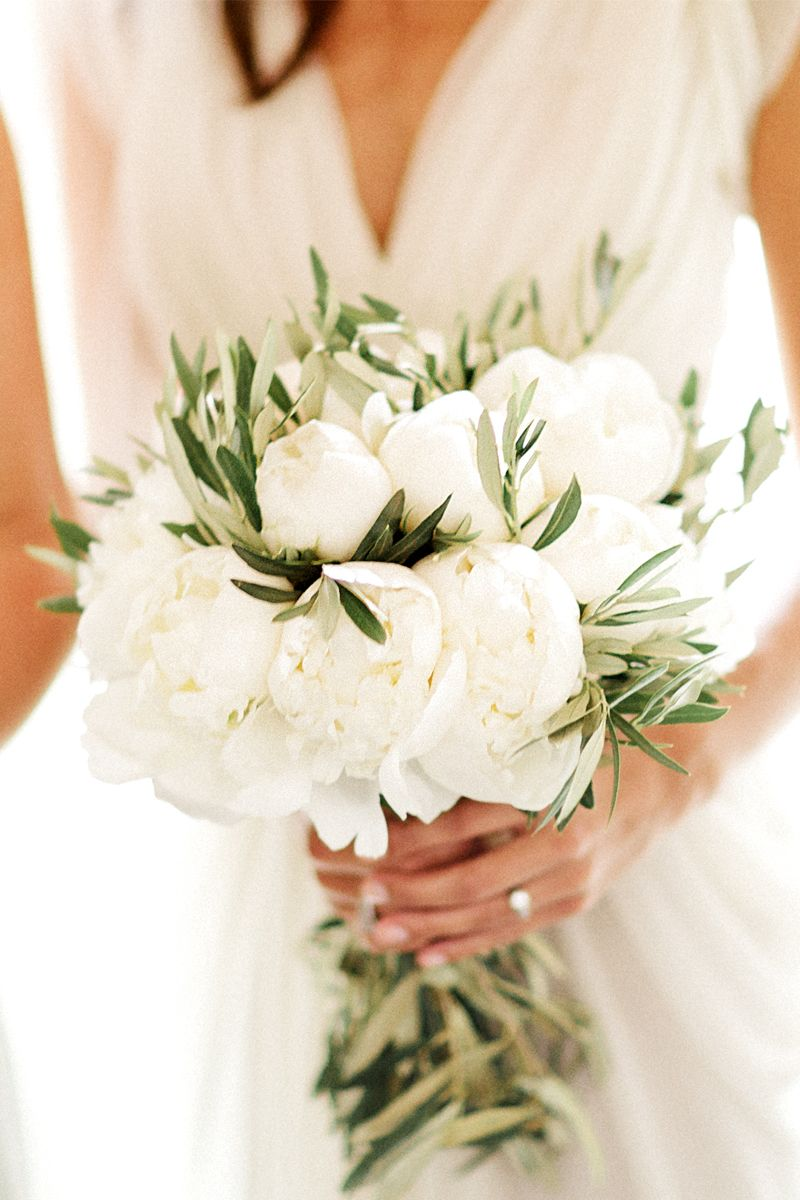 A Bridal Bouquet With Pure White Peonies Accented With Olive