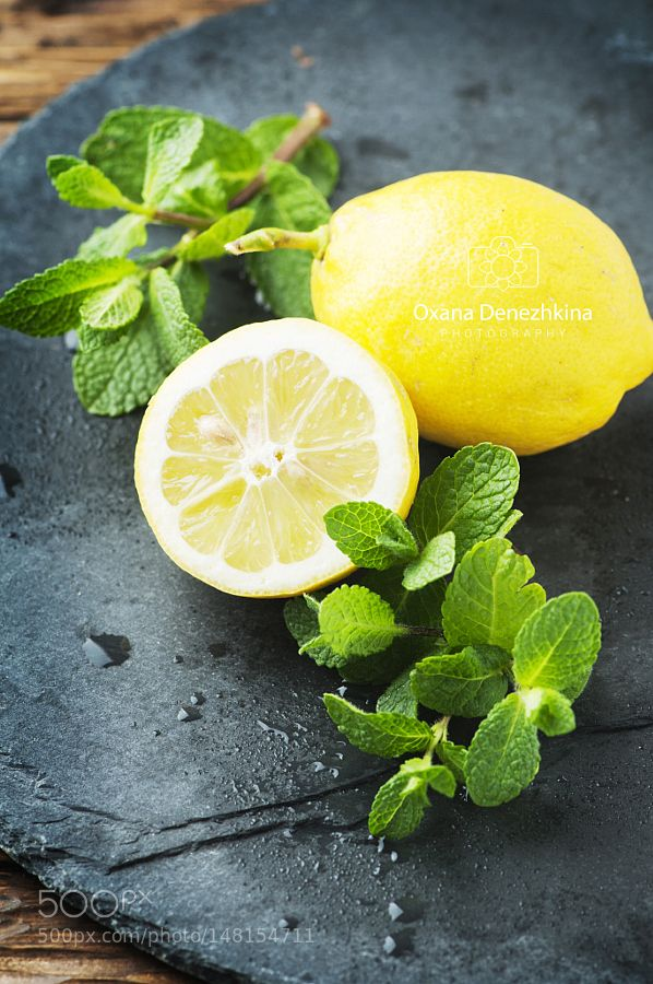 Pic: Fresh yellow lemon and green mint on the table