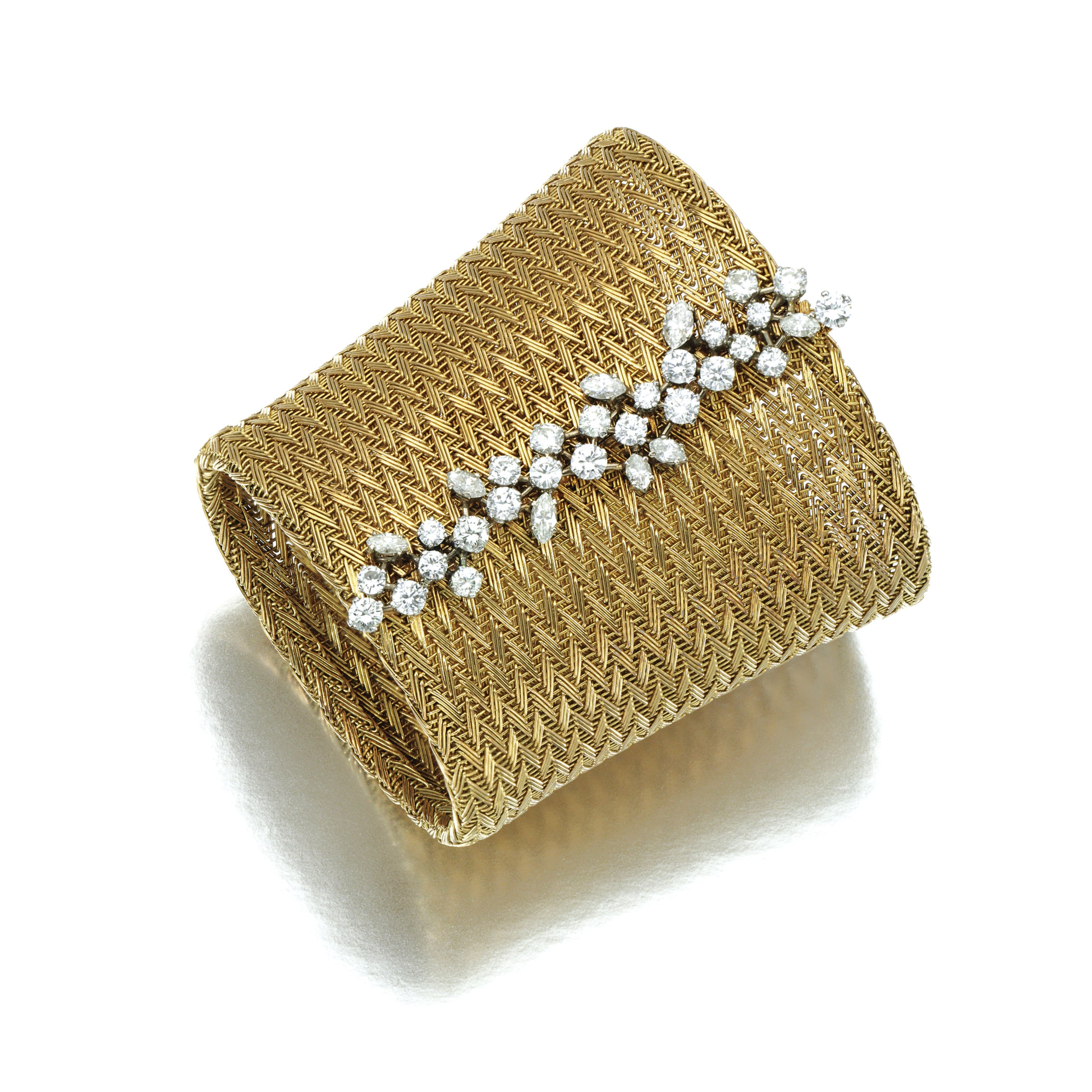 Diamond bracelet designed as a wide tapered cuff of woven basket