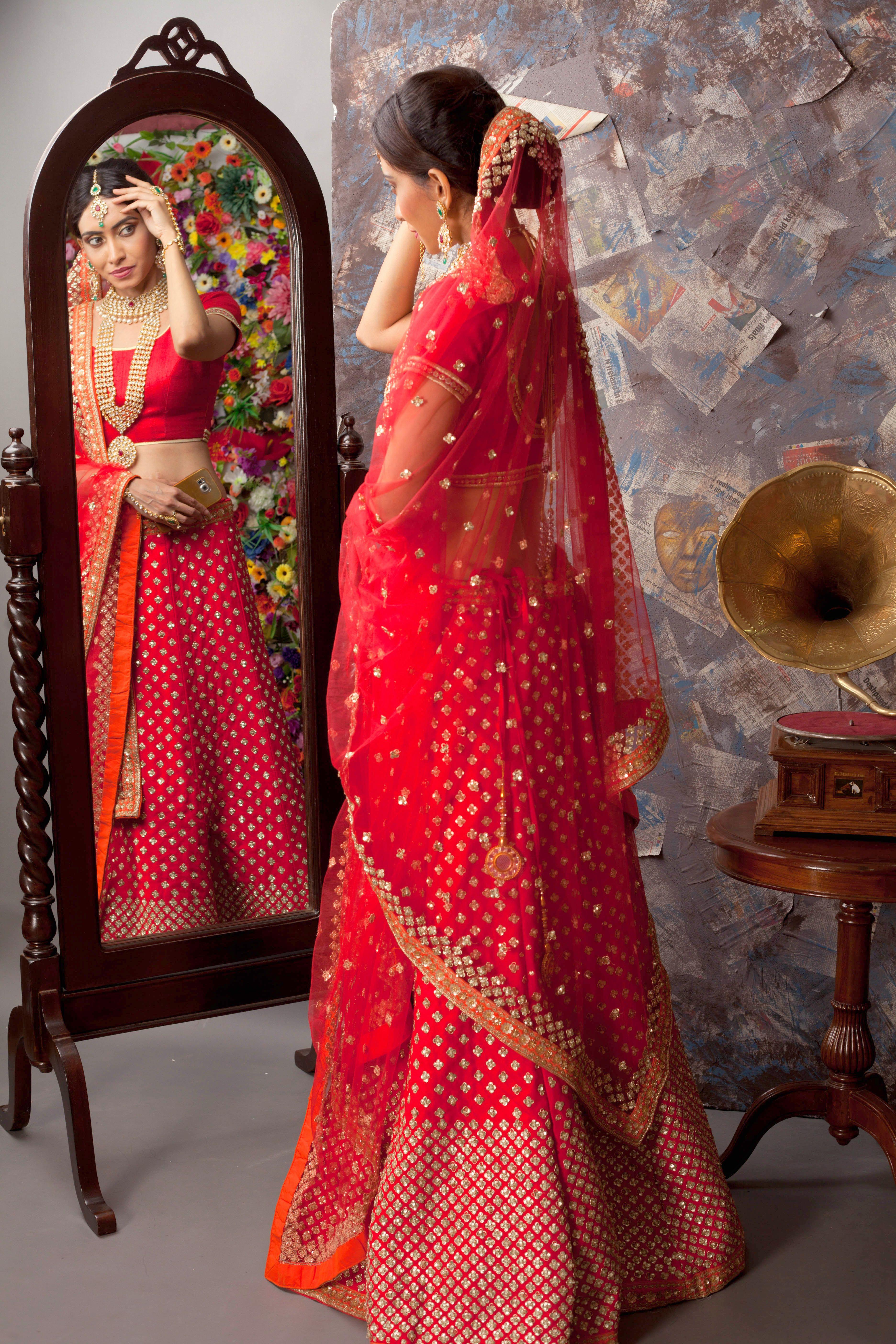 Red Bridal Lehenga Adorned With Intricate Golden Butti Work Our Bridal Lehenga Jewellery Co Indian Wedding Fashion Bridal Lehenga Red Indian Bridal Lehenga
