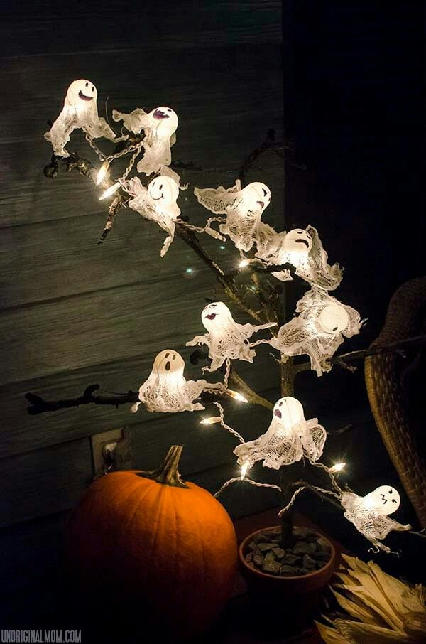 Use ping pong balls, cheese cloth and a strand of lights to make spooky ghost lights