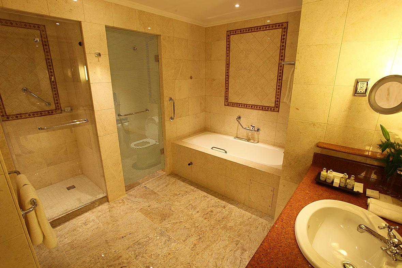 Indulge in at Polana Serena Hotel luxurious soaking tub or refresh ...
