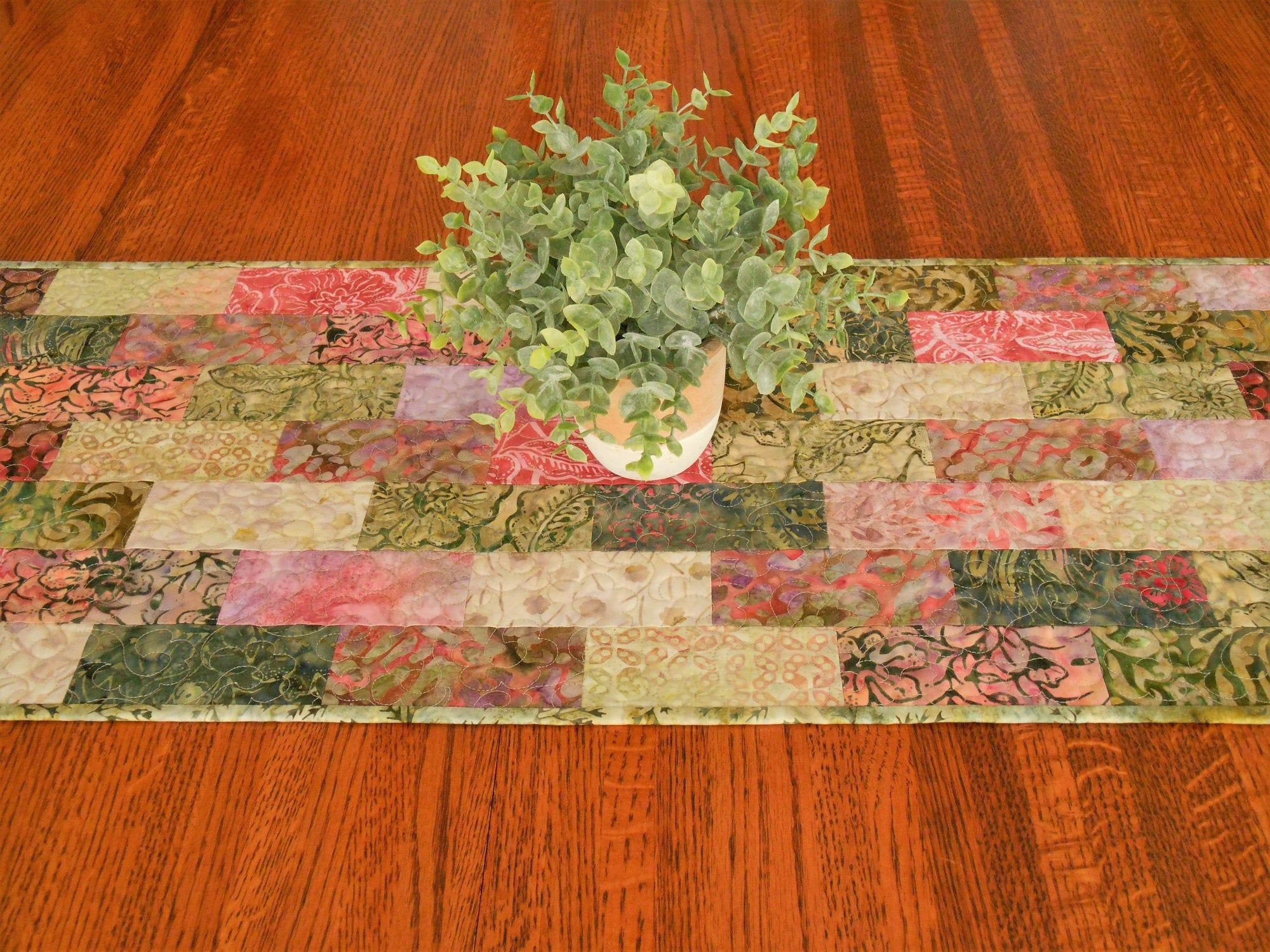 Quilted Batik Table Runner In Shades Of Green And Pink Coffee Table Runner Small Dining Table Runner Batik Table Runners Table Runners Dining Table Runners