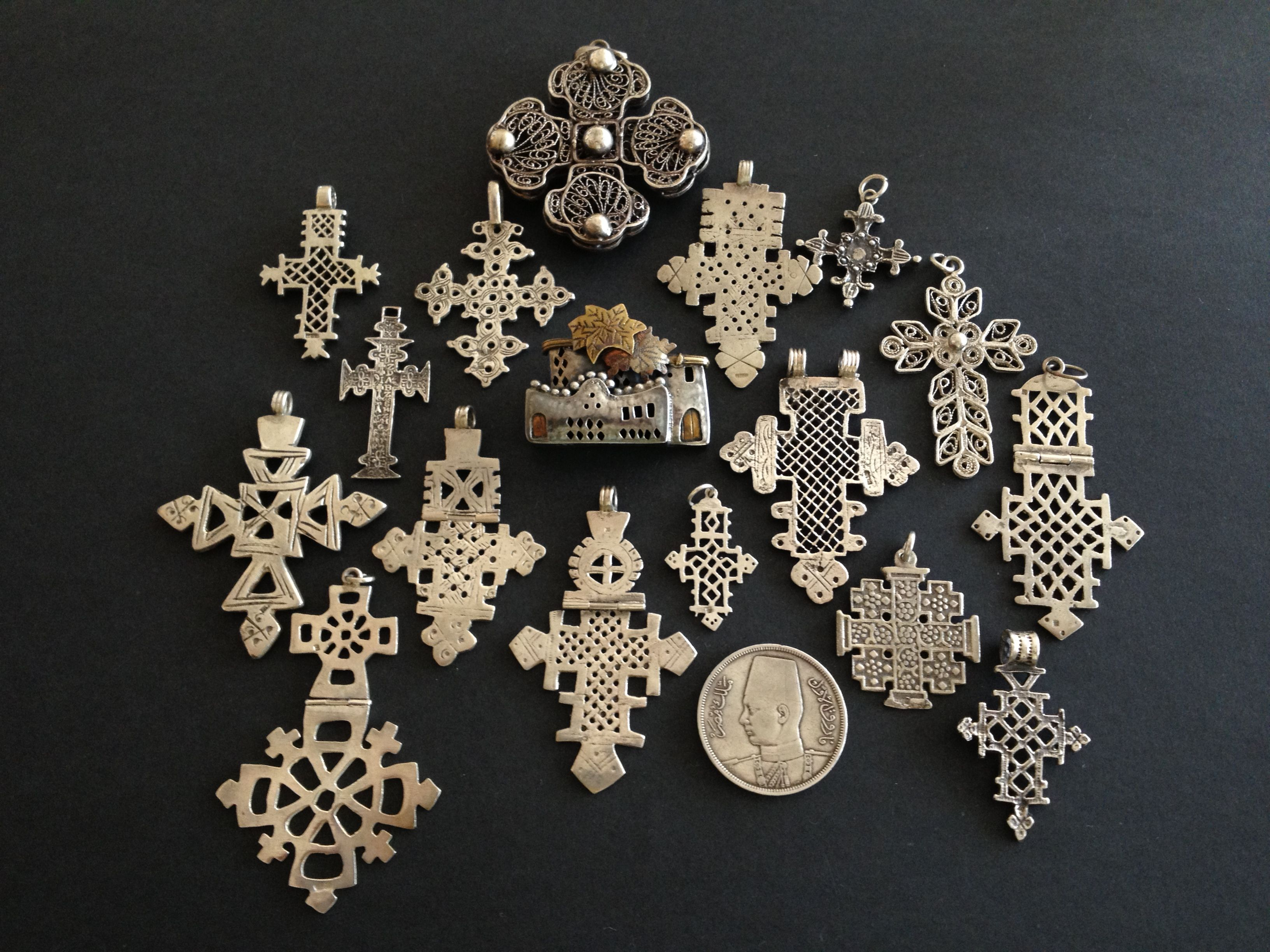 Africa | Set of silver coptic crosses bought in Egypt some 25 years ago. The silver brooch was also bought at that time and represents typical Nubian houses in Upper Egypt. | © Jose M Pery.  { It is worth noting here that there are Coptic people in both Egypt and Ethiopia, which might explain why the crosses look so similar }