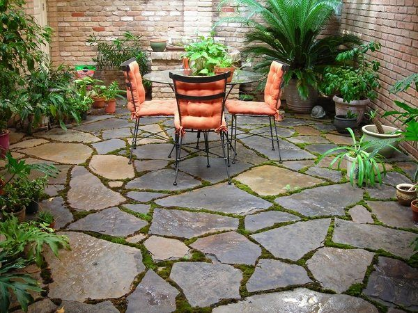 Small Patio Ideas Brick Walls Flagstone Flooring Outdoor Furniture Exotic Plants