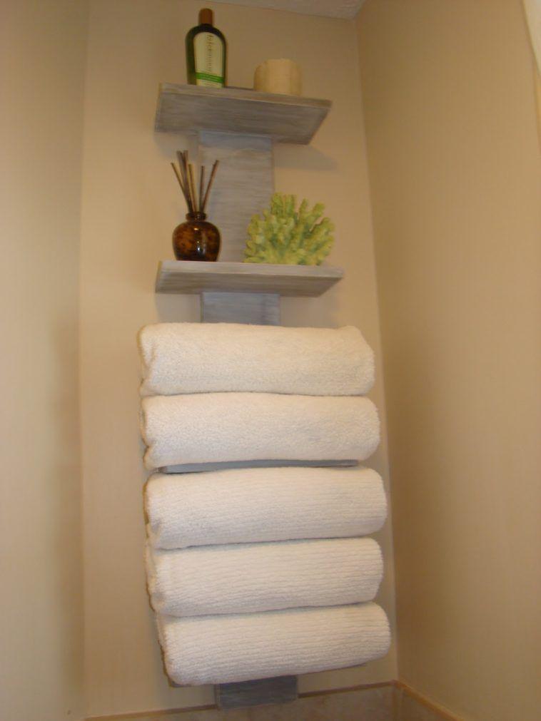 Wall Mounted Wooden Bathroom Towel Storage Hanging On Cream - Bathroom wall towel shelves for small bathroom ideas