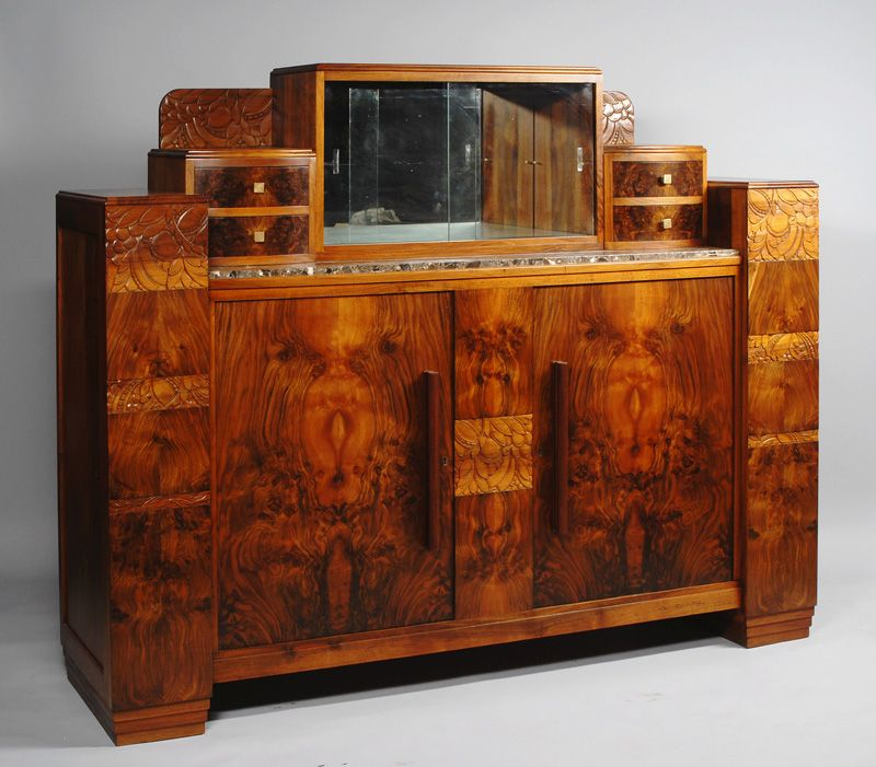 An art deco sideboard book matched walnut veneer with carved detail and marble top