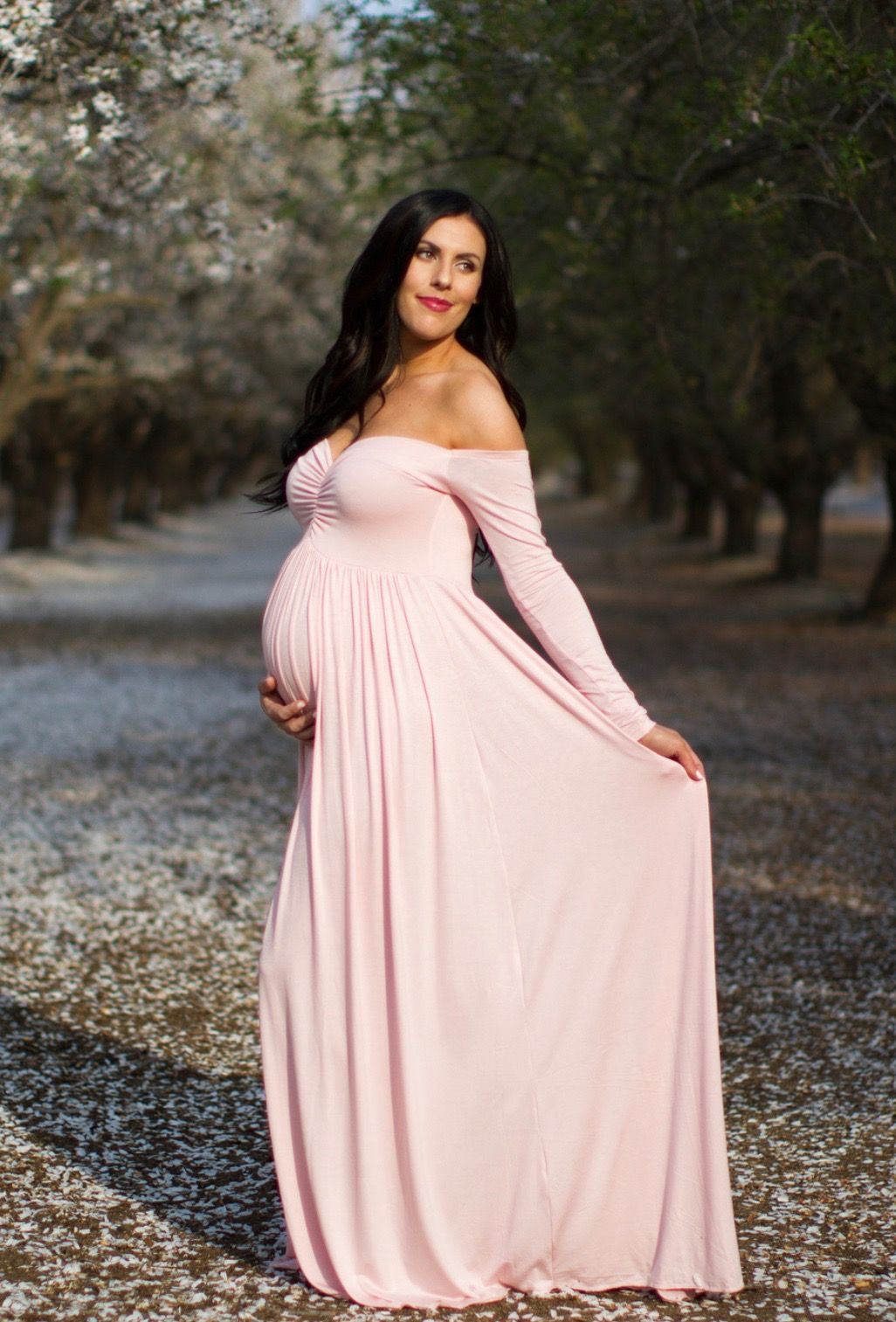 41ded0bf4f5 Hello pretty mama! Happy we found your perfect maternity gown! With a  flared bottom that hits the ground