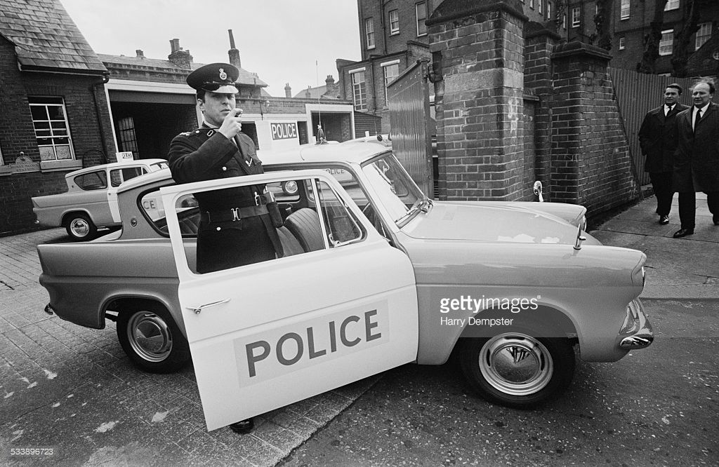Police Officer With A New Ford Anglia 105e Patrol Car 1st March