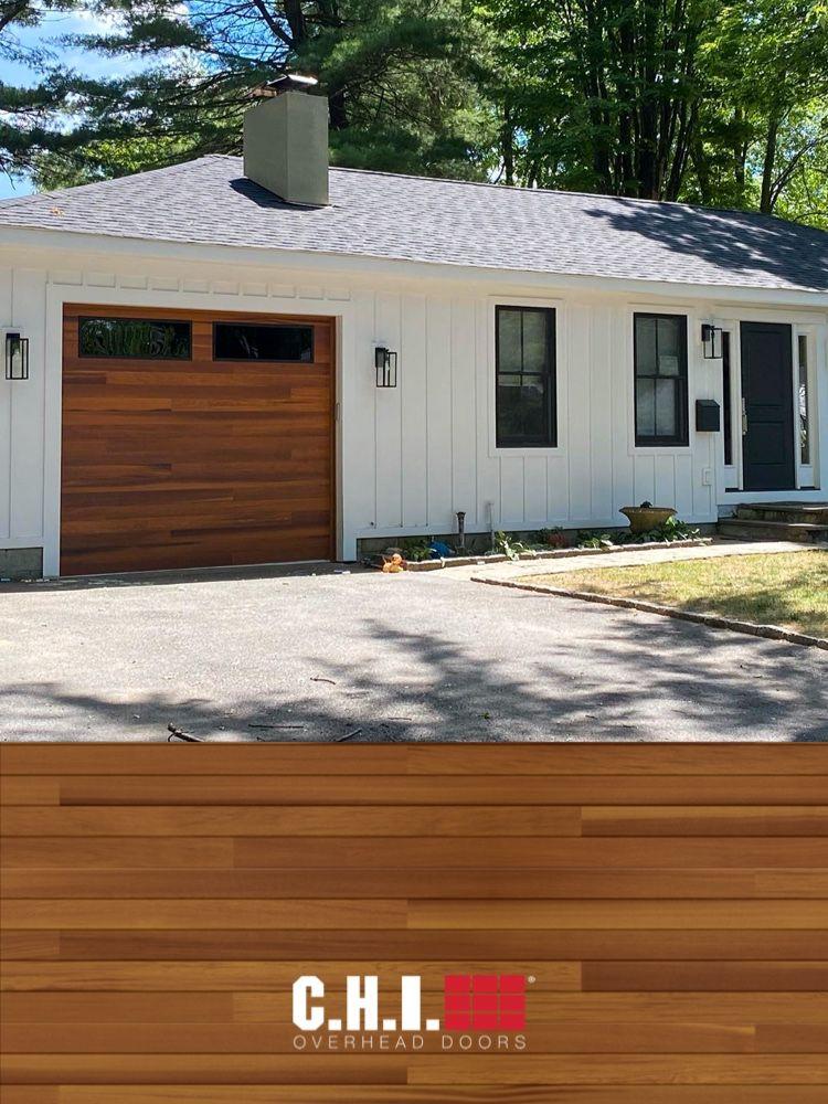 Cedar planks garage door on modern farmhouse exterior