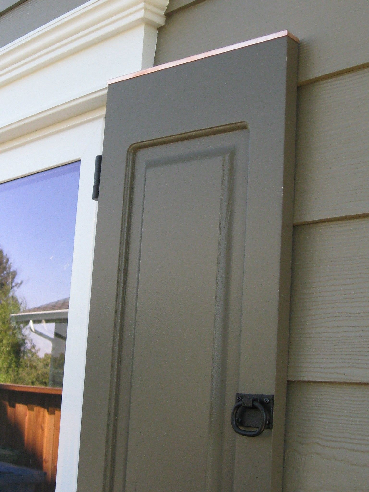 Detail photo of the exterior shutters notice the copper cap on