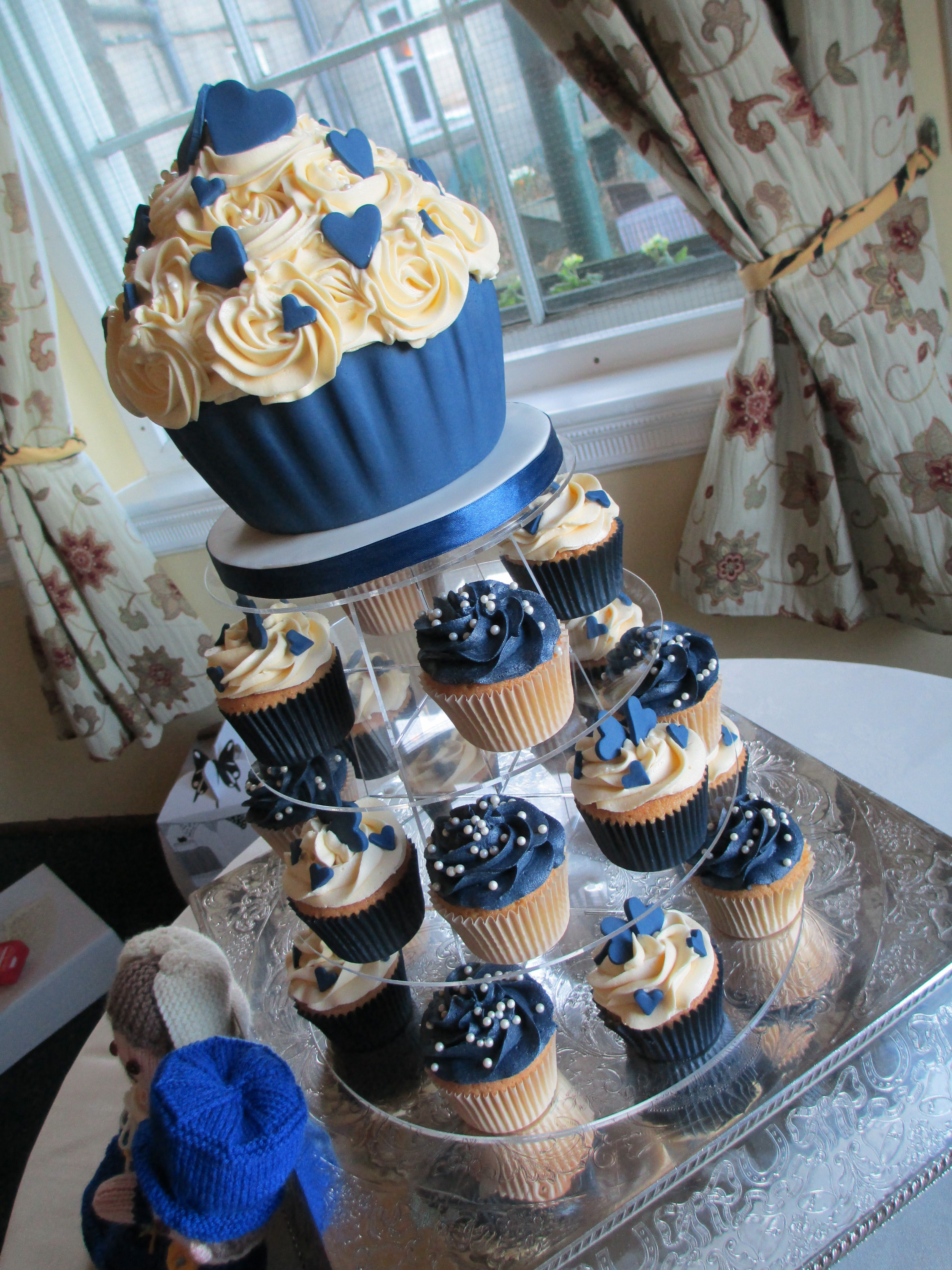 navy wedding cake with cupcakes navy and wedding cupcakes at tregenna castle hotel 17794