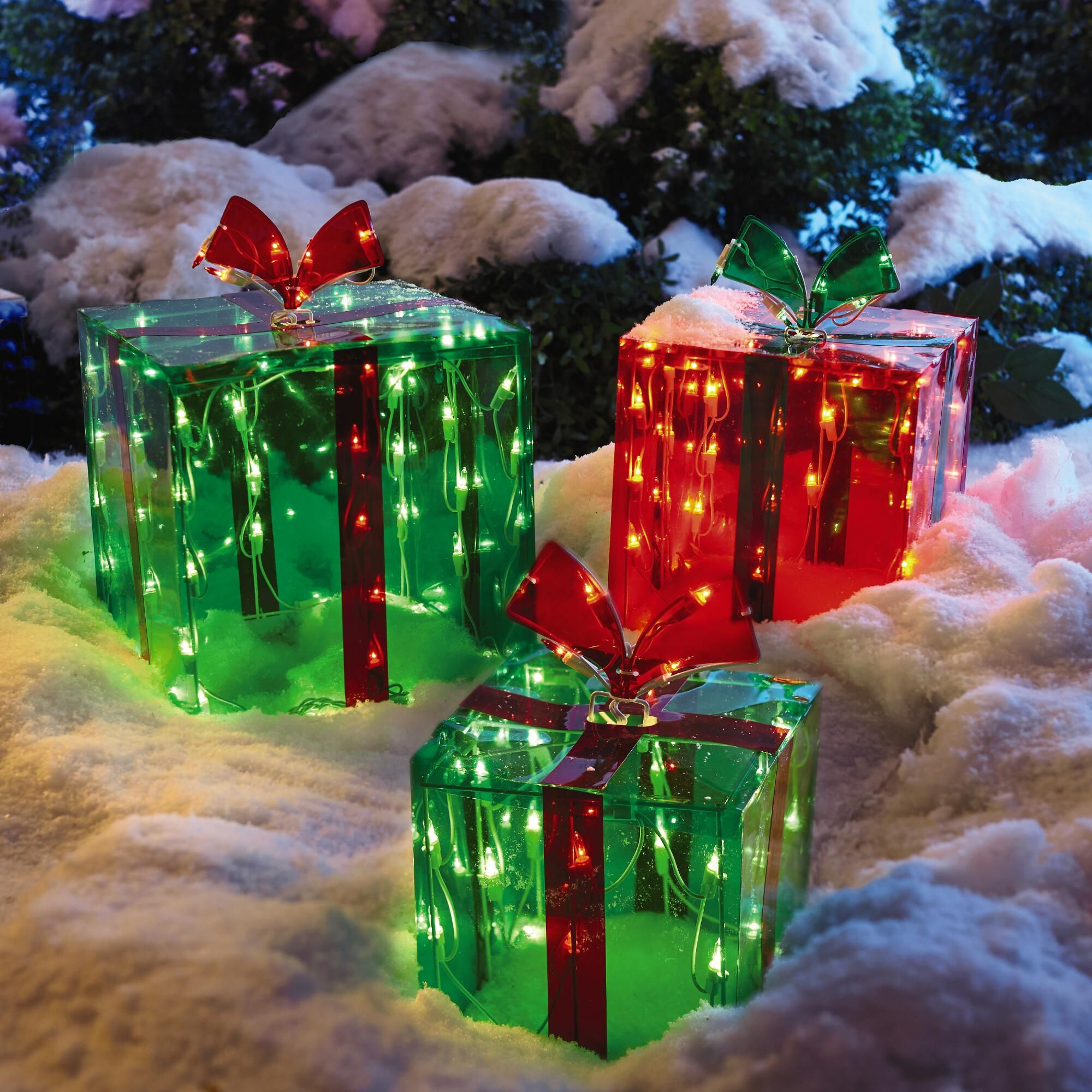 the set of 3 gift boxes with clear lights makes a cheerful holiday statement in the yard on the porch or anywhere inside the house