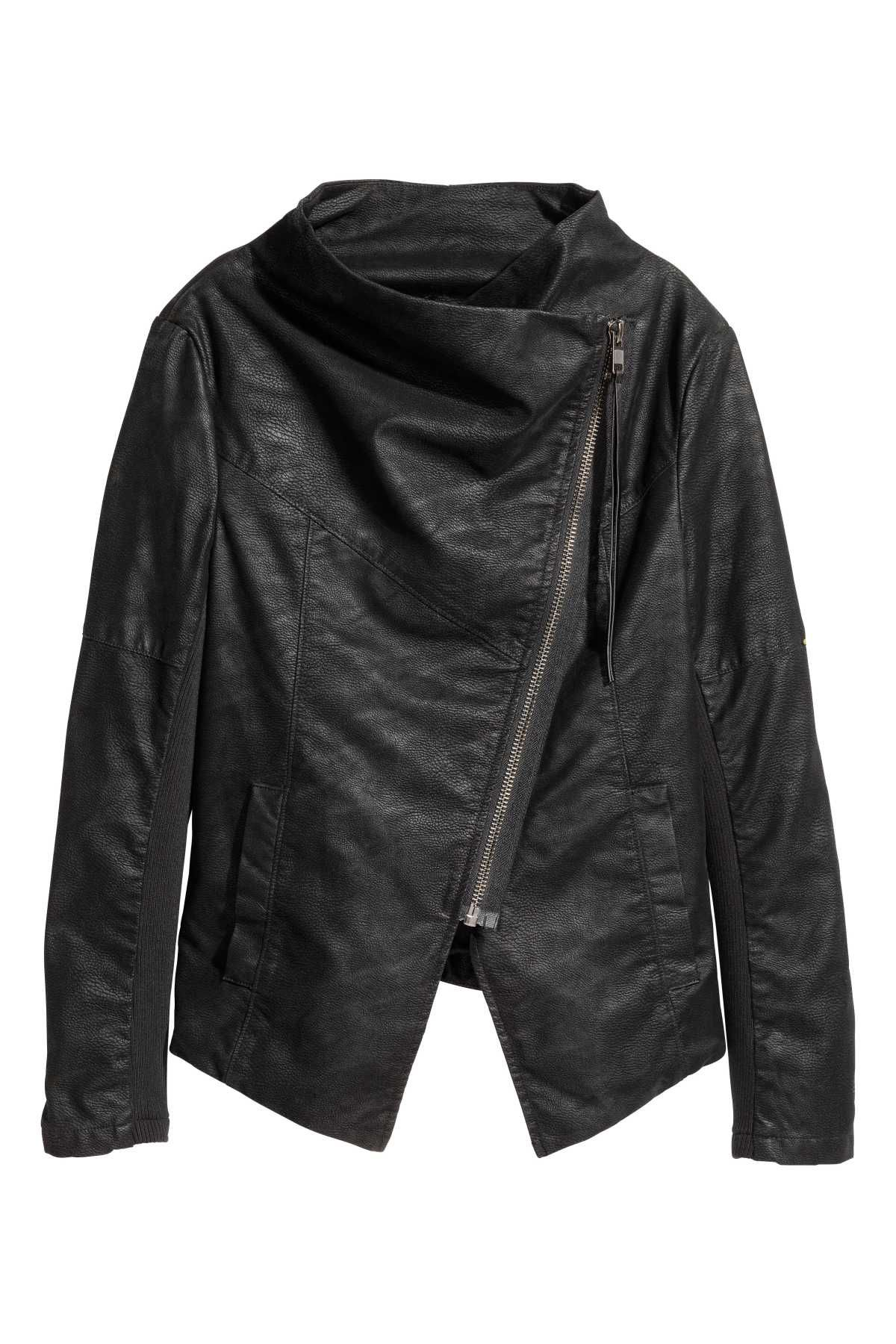 Black. Biker jacket in faux leather with a diagonal zip at