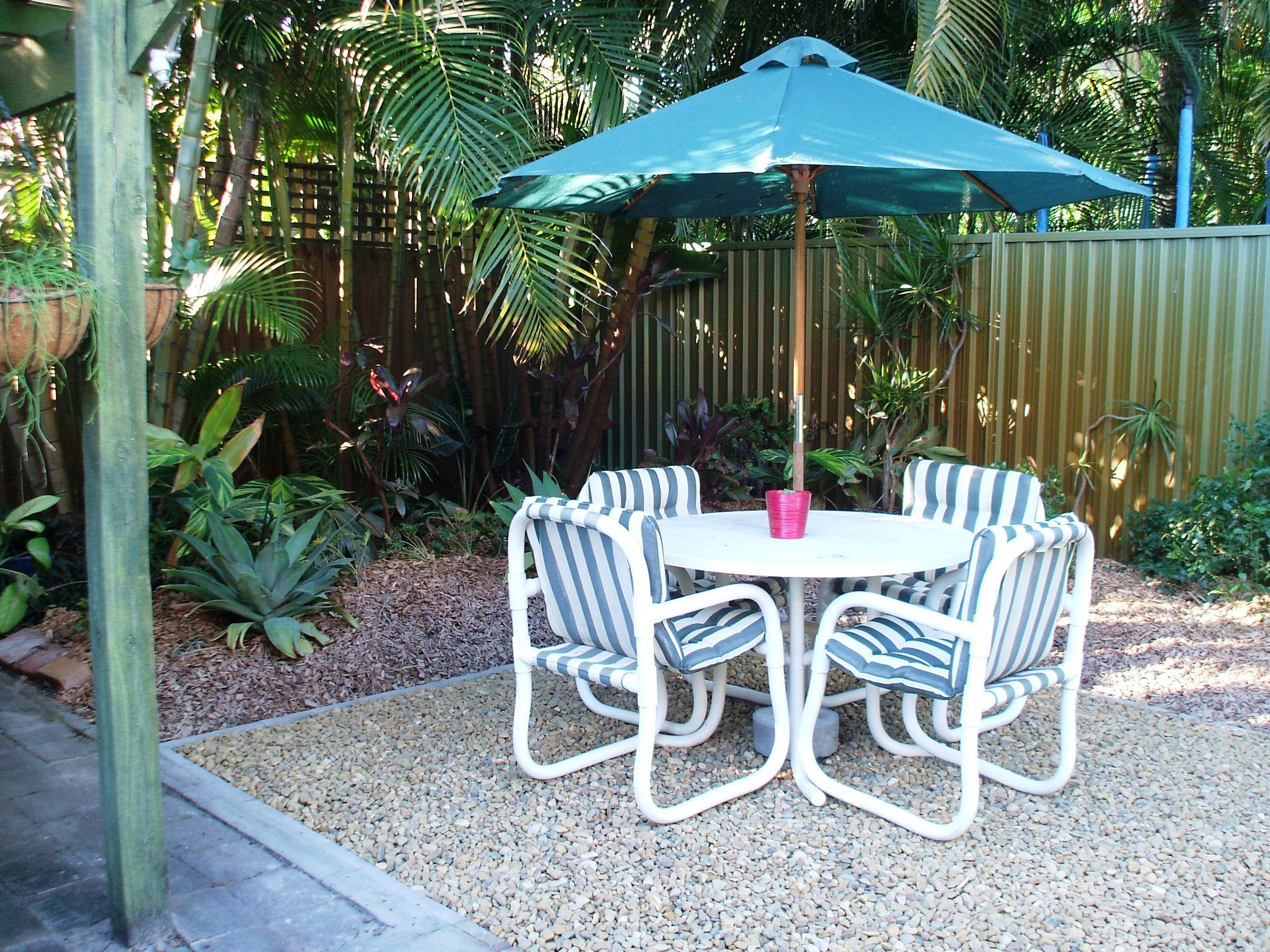 Replace Grass With Pebbles To Create A Low Maintenance Seating Area In A  Small Garden.