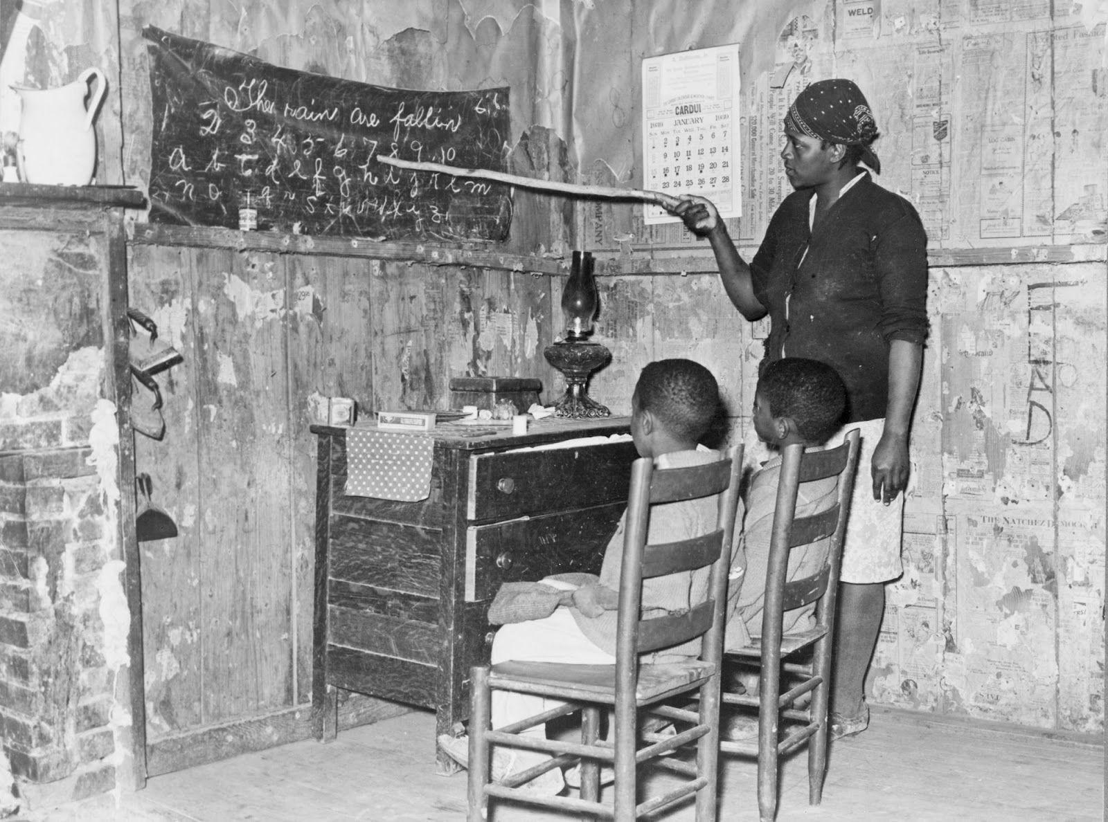 Woman teaching children at home, Transylvania, Louisiana, 1939: Russell Lee