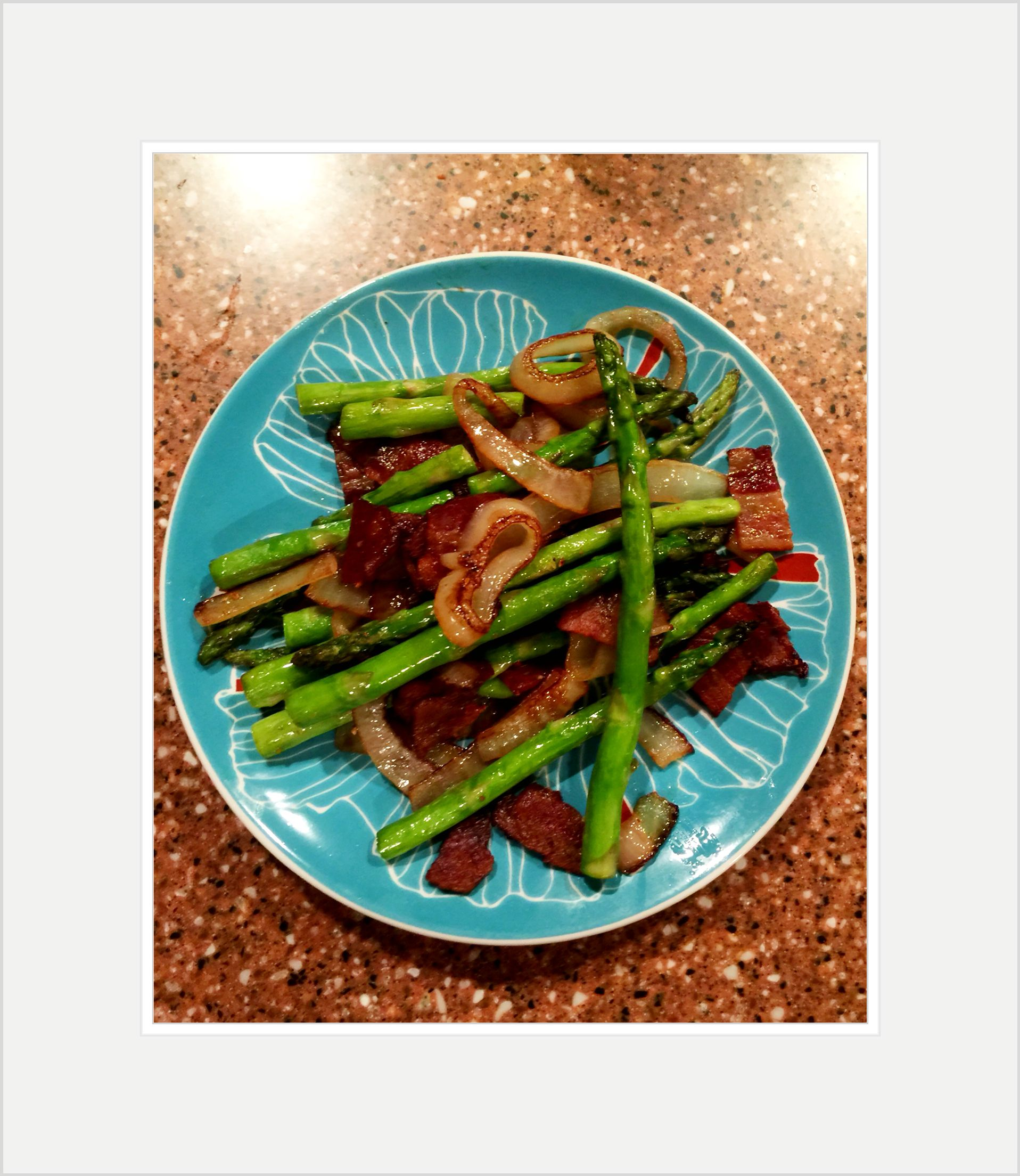 Asparagus, bacon and sautéed onions cooked in olive oil with a touch of garlic and sea salt