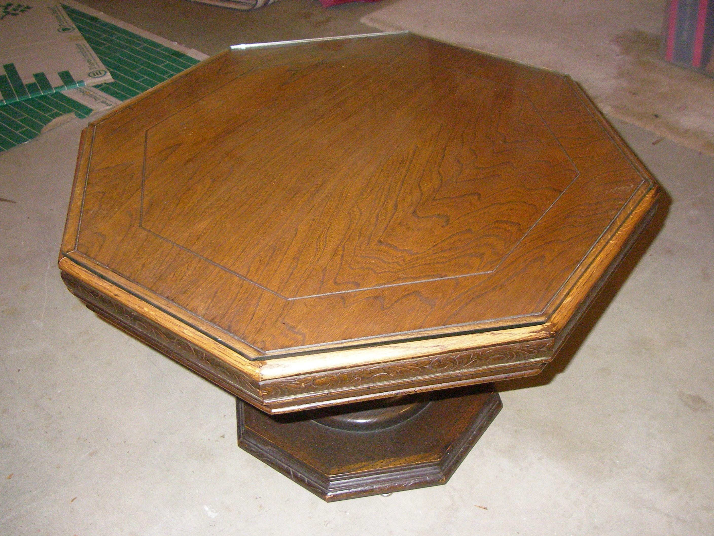 A hexagon coffee table with a glass top hexagon coffee