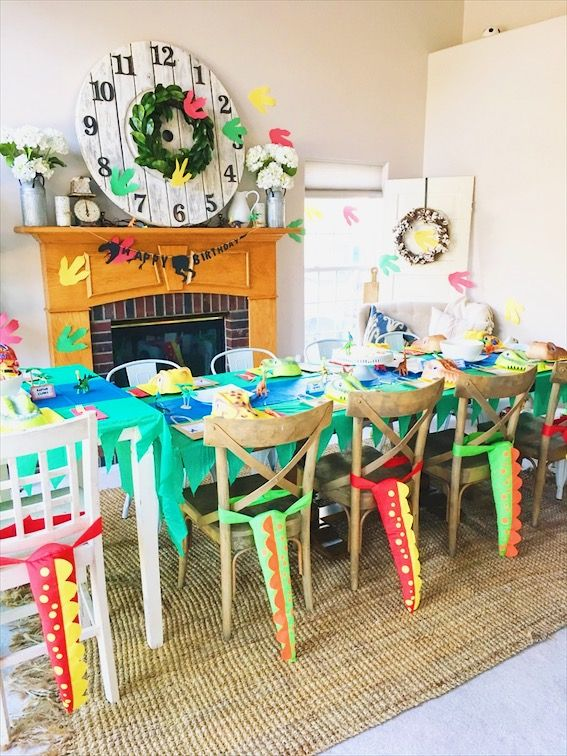Dinosaur birthday party table dino masks tails and free printables