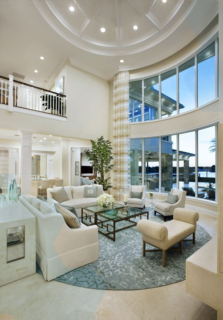 Cool Sunken Living Room Ideas For Your Dreamed House: Stunning Floor-to-ceiling Windows In This Gorgeous Two Story Living Room At Fren
