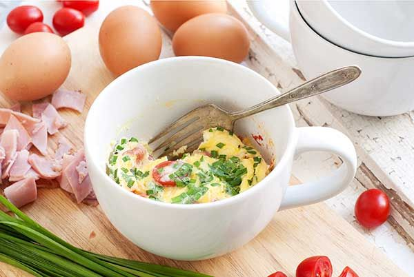 This Quick Quiche in a Mug Recipe is one of the simplest ways to pack protein into your breakfast. One egg gives women 14% of their daily protein.