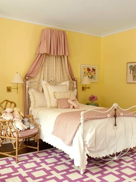 Benjamin Moore's warm Lemon Drops balances pink and purple feminine accents in this children's bedroom