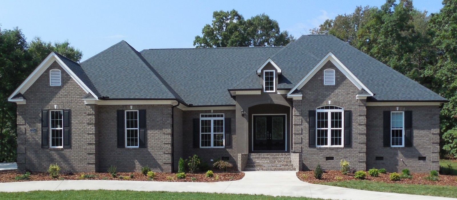 Blog triangle brick home exteriors pinterest Black brick homes