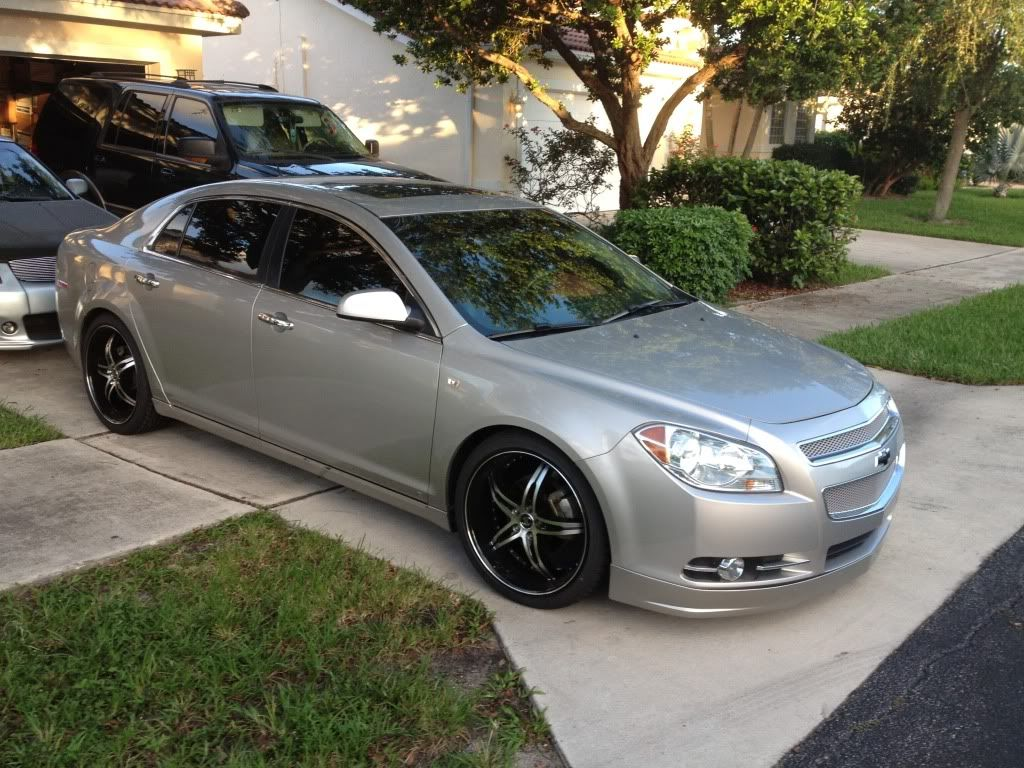 Silver Chevy Malibu With Black Rims
