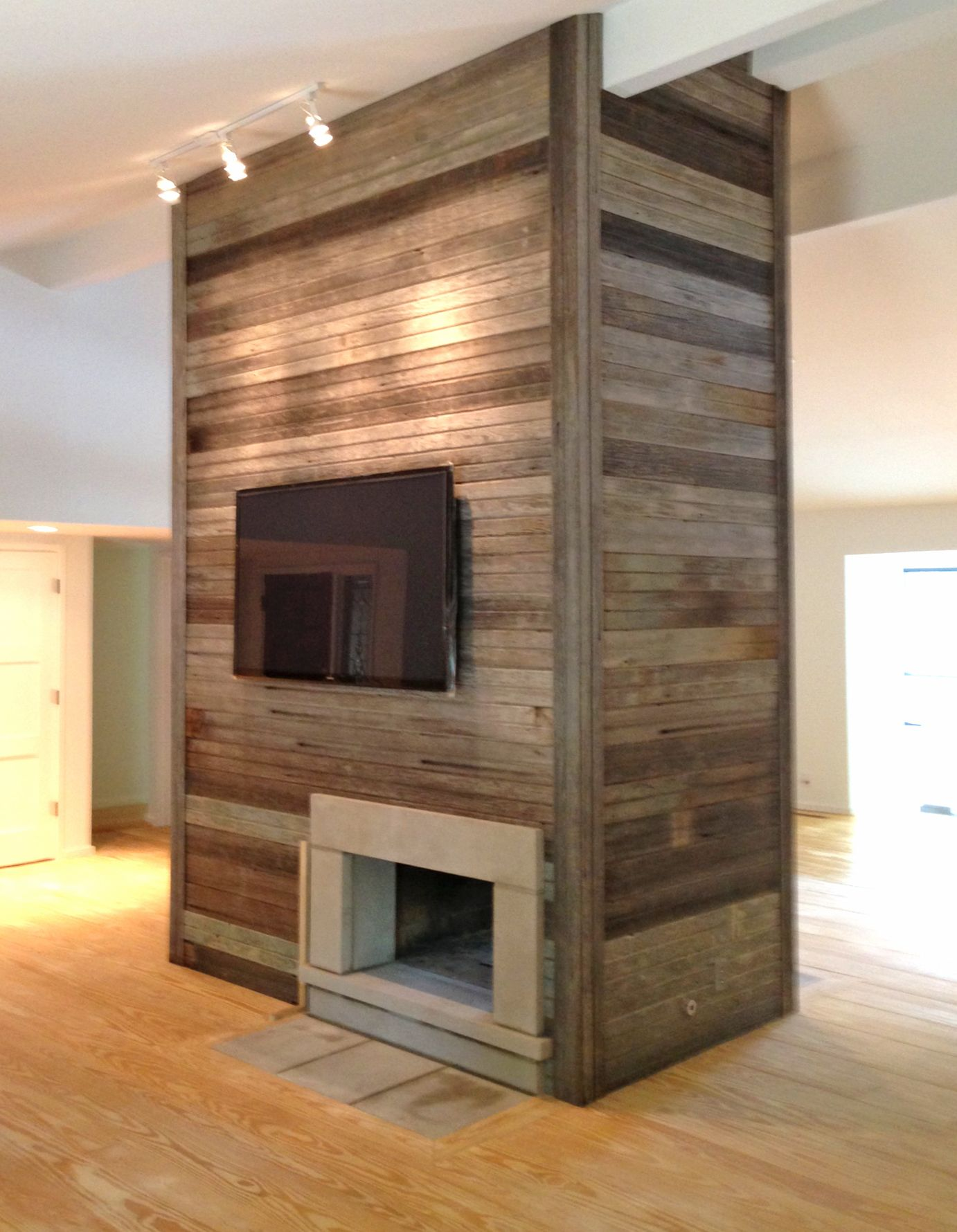 modern fireplace wrapped in carr siding accent walls