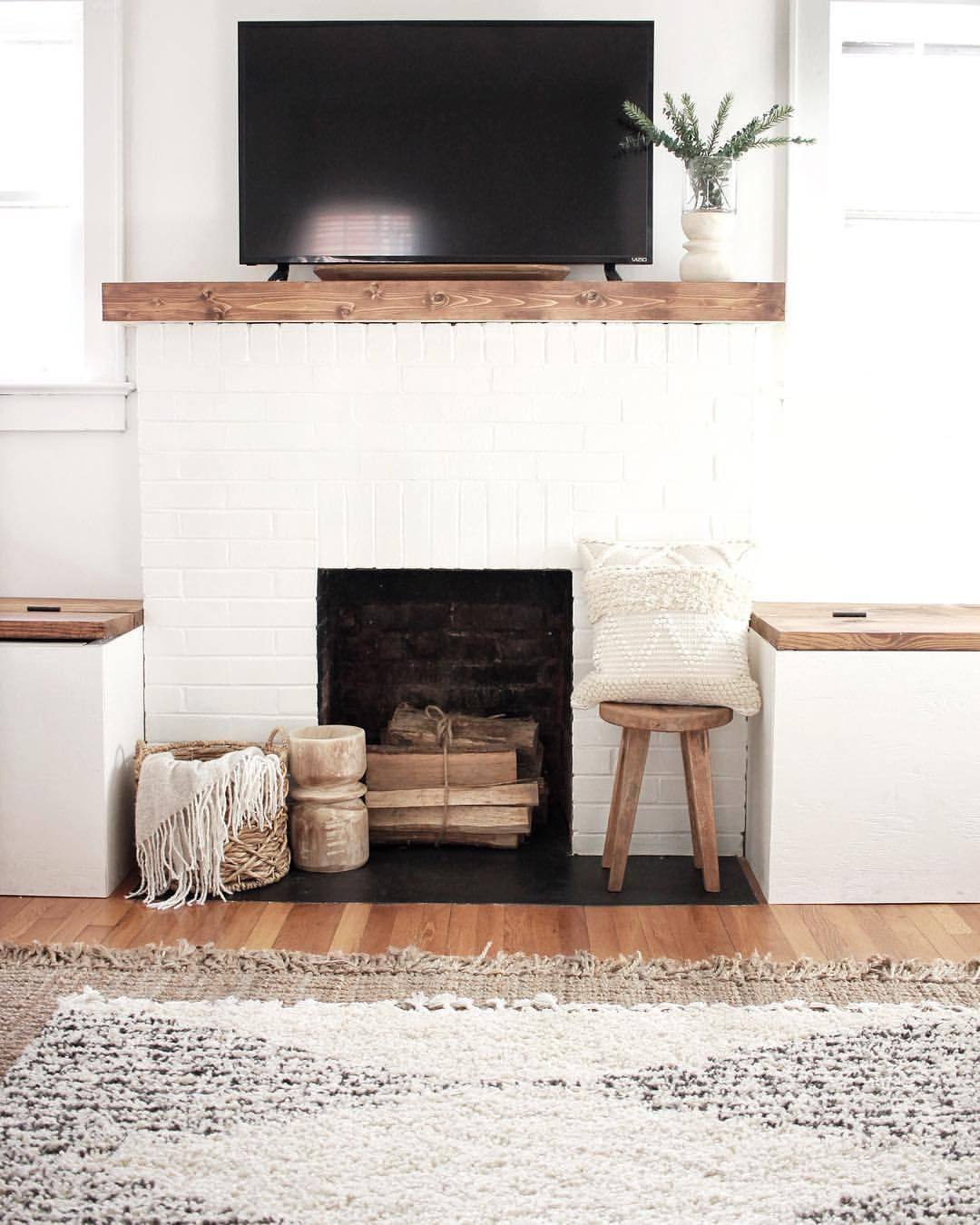 White Brick Fireplace with Warm Woods and Neutral Textures #whitebrickfireplace