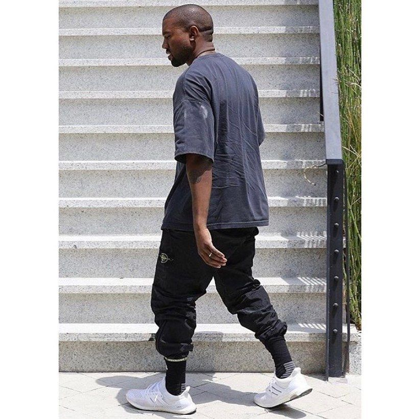 Kanye Omari West On Instagram Ye Rocks Grey Fear Of God Tee Black Stone Island X Supreme Trackpants And In 2020 Kanye West Style Kanye West Outfits Kanye Fashion