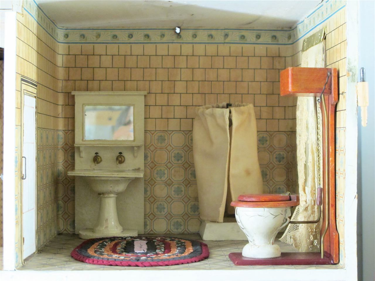 This gorgeous dollhouse is on display at the Strong Museum in Rochester NY.   They call it the Elevator house. I think it is a Red roof Go...