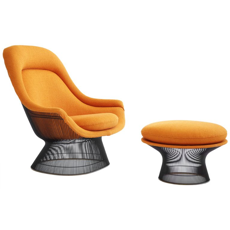 Attractive Orange Warren Platner Lounge Chai  In A Quiet Corner Under Small Hanging  Light