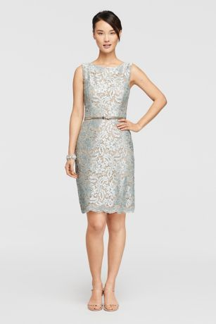 Sequined floral lace adorns this short sleeveless dress with a thin belt that defines the waist.  By Ellen Tracy