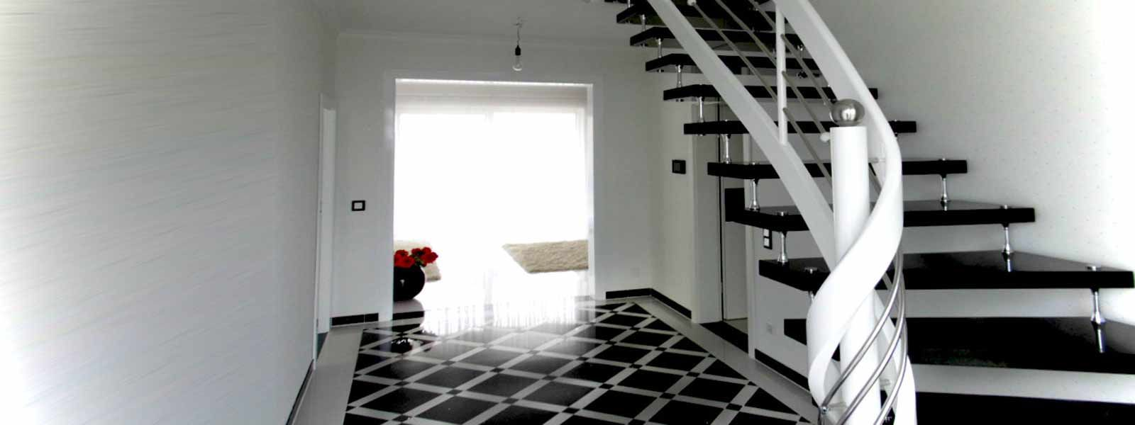 freitragende treppe in schwarz aus granit mit. Black Bedroom Furniture Sets. Home Design Ideas