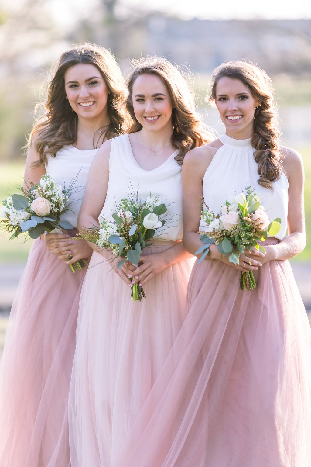 02e424161e Rose Quartz and blush tulle maxi skirts with white bridesmaid tops by Love  Tanya. Affordable and trendy mismatched bridal party