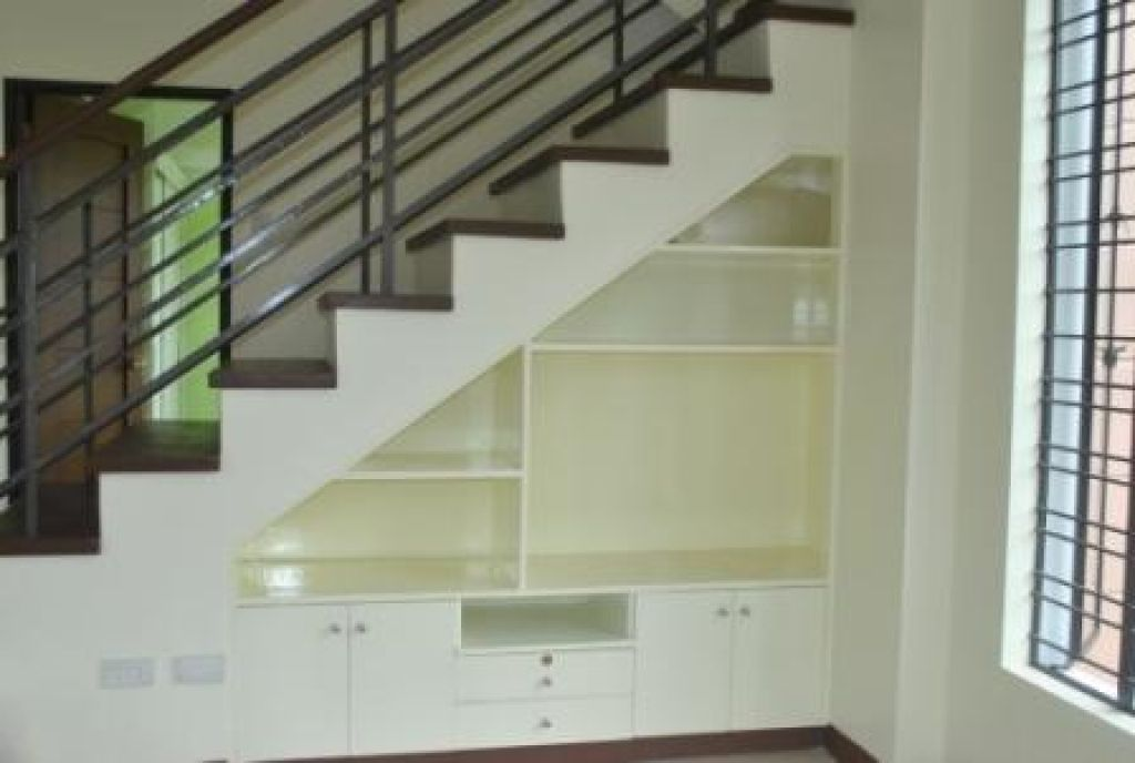 our tv and other things storage under the stairs by