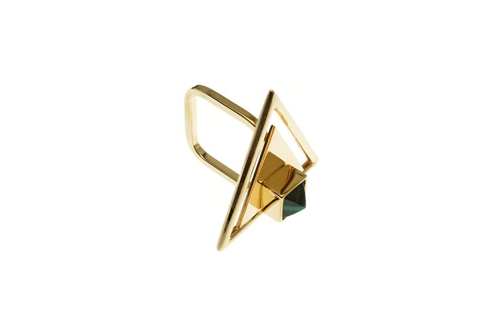 This modernistic triangular ring provides you with the necessary positive energy you need every day. The green malachite gemstone with its magical forces makes every women strong.    COLOR Gold, Malachite gemstone  MATERIAL Brass, 23CT gold plated  SIZE XS, S, M, L    All our products are manufactured in Germany and in our studio in Berlin. Hand-crafted with love and care! Due to its manual assembly process slight differences or irregularities may be expected between the same items and are…