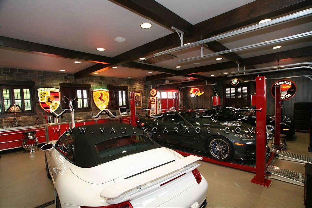 Custom garage design and furnished by vault garages for Custom garage workshop