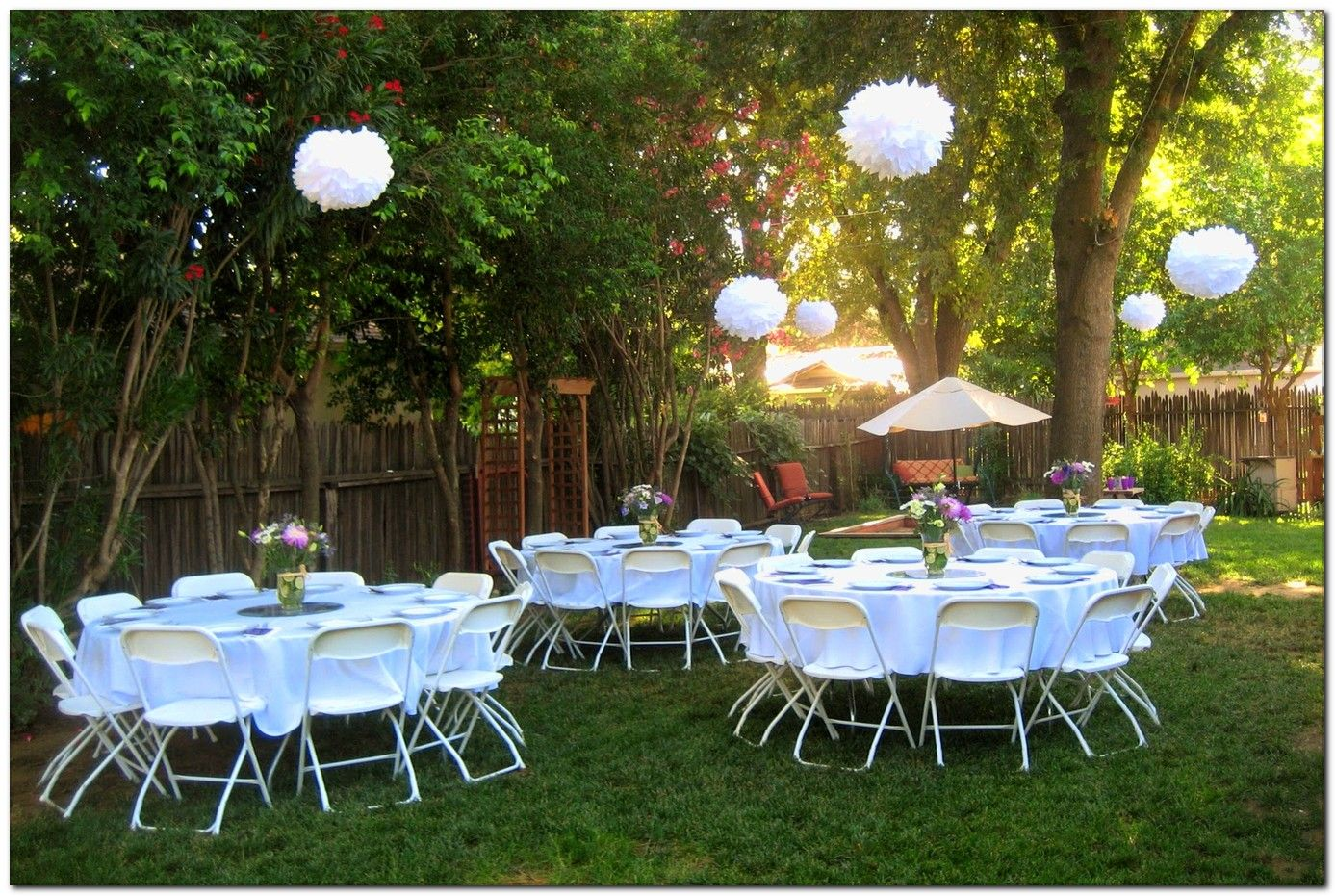 simple and lovely graduation party decoration idea hanging tissue paper pom poms are just. Black Bedroom Furniture Sets. Home Design Ideas