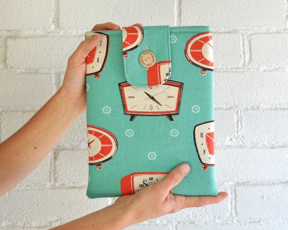 ipad cover. Retro Padded Aqua Clocks, via Etsy.