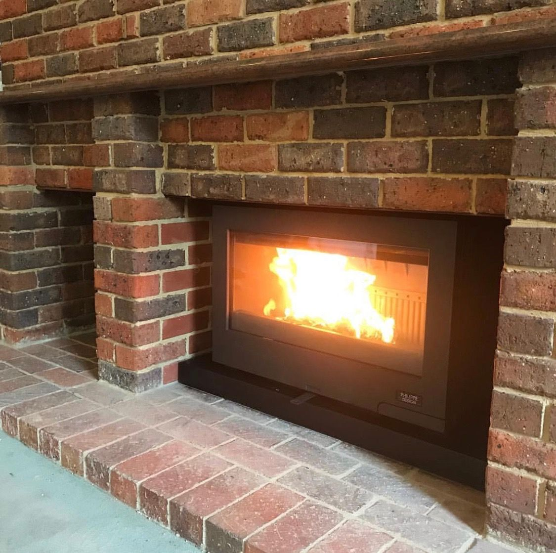 The Cheminees Philippe Horama Installed Into This Perfect Brick Fireplace Installation By Fireworx Retractable Glass Doors Fireplace Brick Fireplace