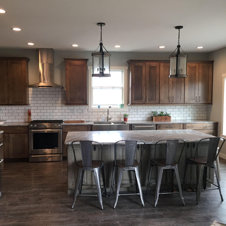 Grey kitchen island with maple wood cabinets. Subway tile ... on Modern Kitchen Backsplash With Maple Cabinets  id=86569