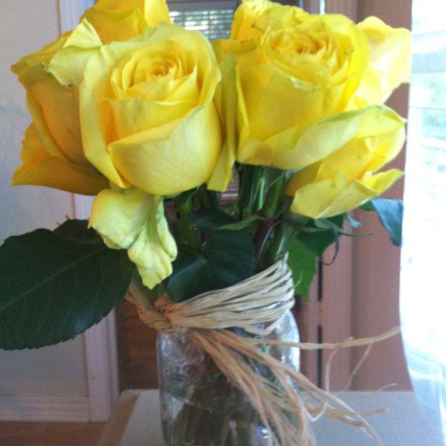 Yellow roses in a mason jar... love yellow roses.
