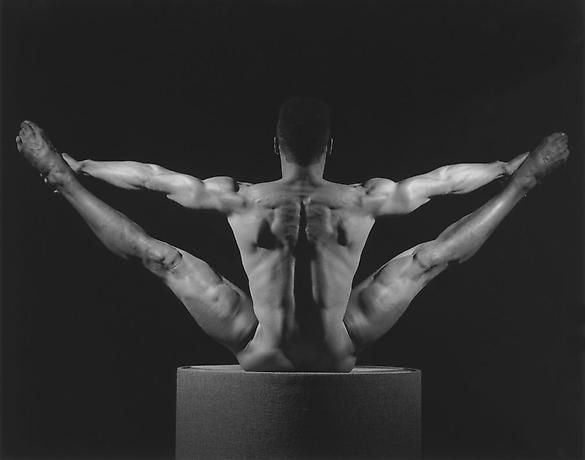 This is a photograph by Robert Mapplethorpe. Robert liked to capture pictures of the human body and this specific photograph emphasized his perspective of male beauty.