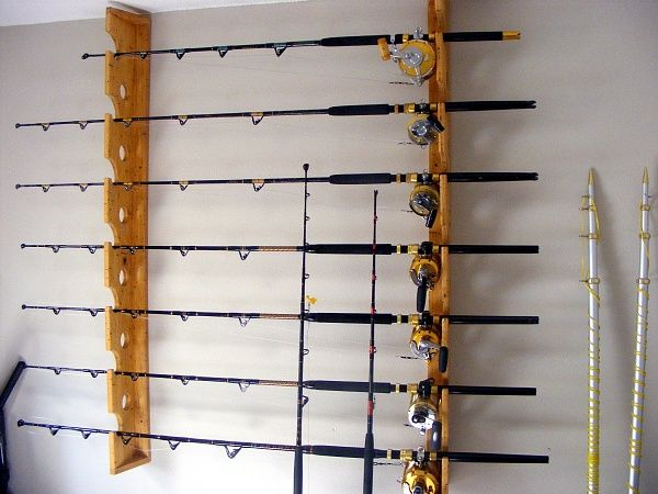 Wall mount fishing pole holder can totally diy with for Diy fishing pole rack