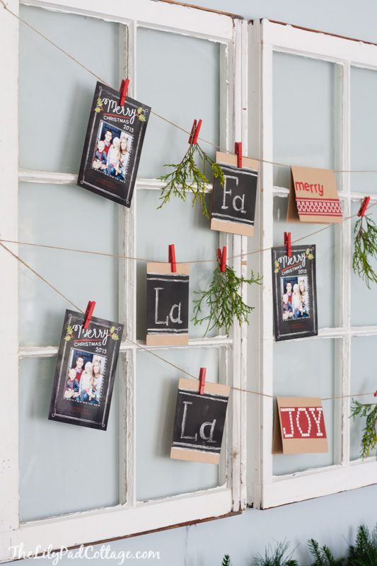 easy christmas card display made with old windows twine and clothespins