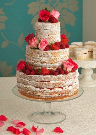 Naked cake topped with berries and roses