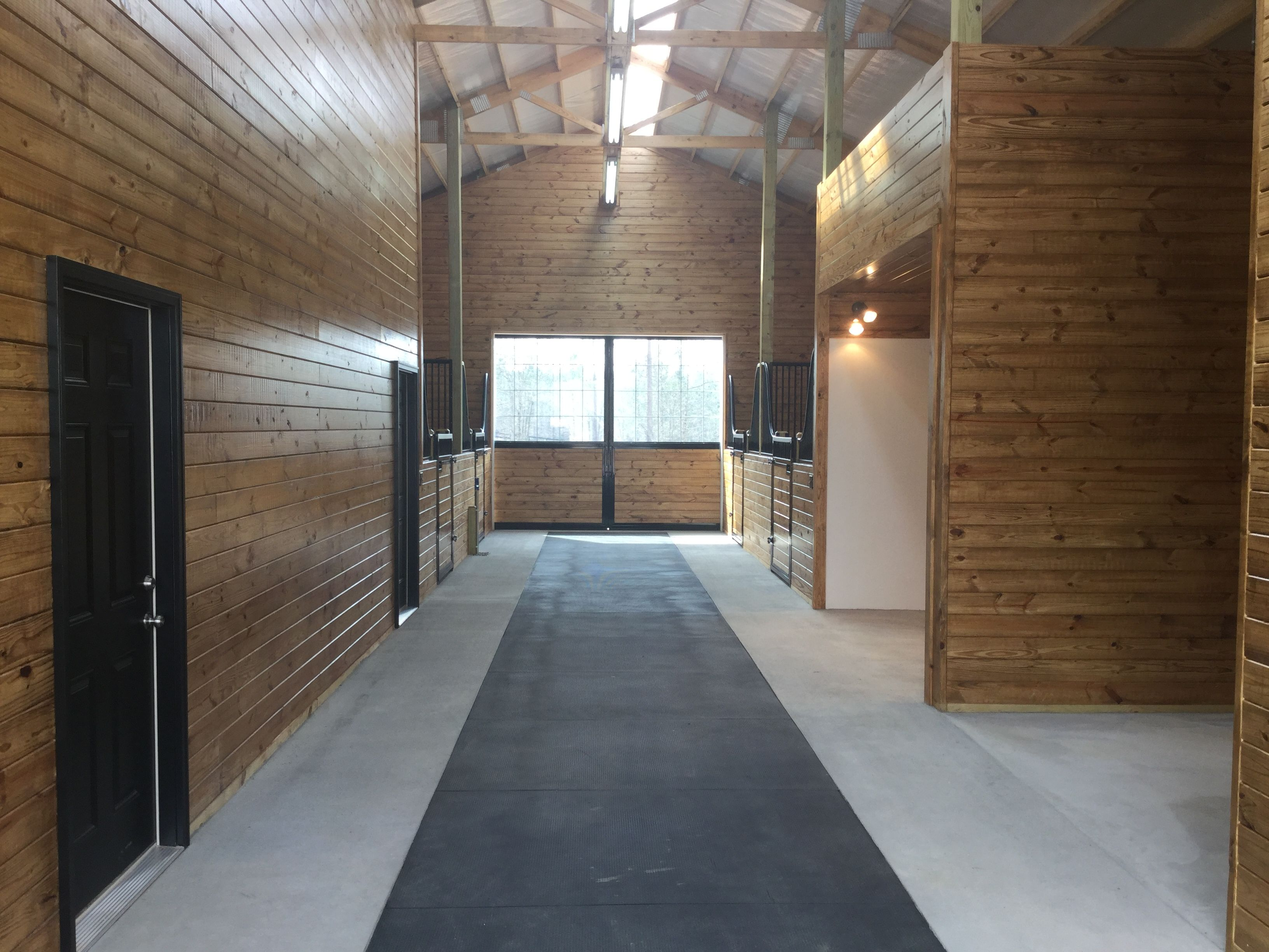 Horse Barn With Rubber Mats Down Center Aisle With Flush